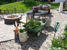 Various planters. Planter Ideas, Planters, Vintage Farm, Wheelbarrow, Yard Art, Garden Tools, Stoneware, Primitive, Patio