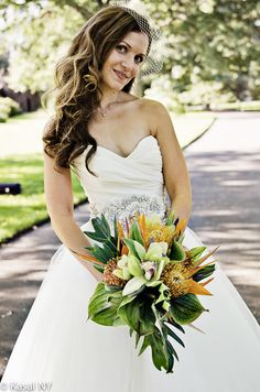 Like this bouquet. But add tuberrose, gardenias and more orchids