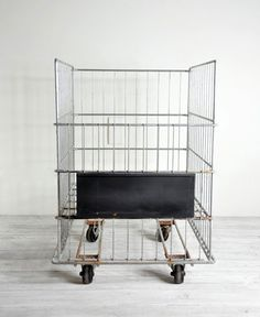 Industrial Wire Cart With Label Space on Front. (How perfect would this be for laundry hampers?!)
