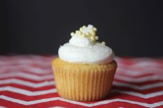 The Lemonade Lucy, a tribute cupcake for President Rutherford Hayes. Lemon-vanilla cake filled with lemon curd and topped with lemon meringue frosting and yellow sugar pearls.