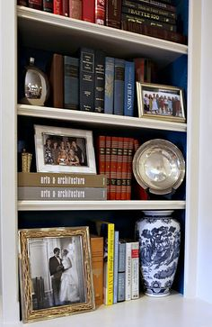 I love the addition of framed photos to Book Shelves