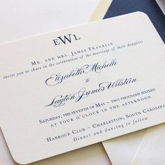 Traditional navy wedding invitation with monogram at top and rounded corners. With navy belly band. Blush Paperie