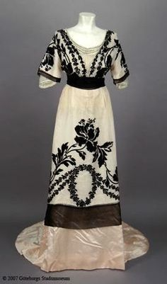 Edwardian white and black gown with applique and flower decoration