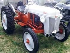 Ford 9N Tractor  Now picture this, a thirteen yr old driving one of these, with a brush Hog (Rotory Mower), going down the main street, passing many young girls along the way, Does that say DORK on not.  I had to cut a field about 10 miles from our place 4 - 6 times a summer.  Fun