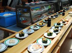 Conveyor belt sushi. We call this 'Kaiten Sushi'. Almost 1 dollar each. I like this.