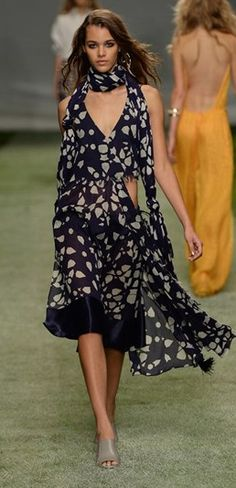 LOVE this asymmetrical dress