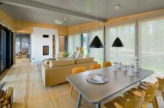 Honka Lokki. Furniture has been kept to a minimum to allow natural light to…
