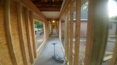 after removing large posts alongside walkway started on building frame for the hallway