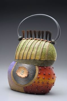 Tarsus Purse made of colored polymer clay with intricately hand-applied texture in layers of pattern.