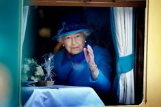Queen Elizabeth II, on the day she becomes Britain's longest reigning monarch, waves from a carriage window at Edinburgh's Waverley Station, after boarding a steam train to inaugurate the new £294 million Scottish Borders Railway