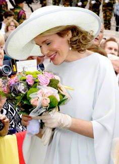 Queen Mathilde (L) and King Philippe - Filip (R) of Belgium attend the military parade on the Belgian National Day on July 21, 2015 in Br...