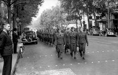Paris, Aug 1940: Female German company marches. the female auxiliaries were quite notorious......