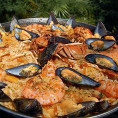 Paella Ingredients 1  onion  1  chicken cut into pieces   salt   pepper  1/4 cup  olive oil  2 cloves  chopped garlic  1  onion (chopped)  2 cups  rice  1/2 lb  cod fish (fillets)  1/2 lb  shrimp  1 lb  clams  1 lb  mussels  1 lb  linguica (sliced into 2 inch pieces)  1  red bell pepper (sliced)  2 cups  stock (shrimp/chicken)  ? Tasty tip   Knorr® Homestyle Stock™  1/2 cup  white wine  1/2 tsp  saffron 1 cup  frozen peas   hot pepper sauce