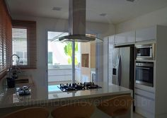 Resultado de imagem para cozinhas integradas com pia embaixo da janela