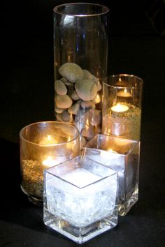Centerpieces to represent each Divergent faction.  Gray stone, broken glass, sand (with gold glitter),mini black rocks (coal), & glass stones in water.  Submersible LED lights & tealights were added to create a more elegant feel!