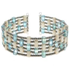 This cuff uses the CzechMates two hole rectangle beads as the perfect spacers for the rings of memory wire.