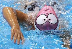 Everybody out of the pool! Jennet Saryyeva of Turkmenistan has some fun by wearing a not-so-menacing swim cap during a training session in Olympic Park.