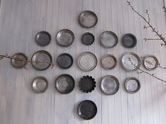 Antique pie tins, perfect breakfast nook wall decor