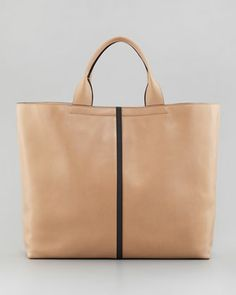 "Track Leather Tote Bag, Almond by Reed Krakoff Tote handles with 5"" drop. Open top. Inside, contrast leather lining; two magnetic pockets. Flat bottom. 13 1/2""H x 15 1/2""W x 5""D."