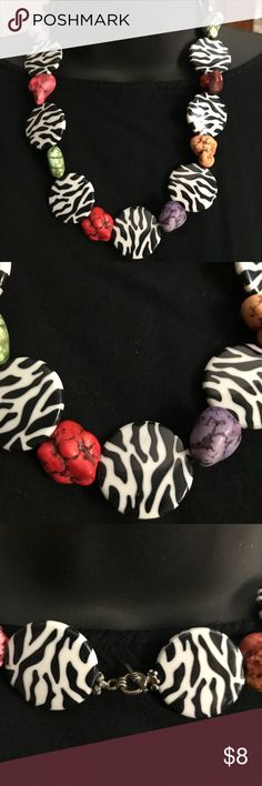 """Fashion Necklace Make a fashion statement with this Necklace. Check out the pictures. Has a leopard pattern on man made material with It's unique multicolored rocks. 18"""" in length. Perfect condition. Jewelry Necklaces"""