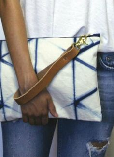 I dream in indigo, my wanderlust starts at blue. The timeless appeal of blue and white is the inspiration behind the hand-dyed Shibori tortoiseshell or Kikk patterning on this organic cotton canvas clutch.~ x hand-dyed organic cotton canvas ~ l Shibori, My Bags, Purses And Bags, Indigo, Diy Sac, Do It Yourself Fashion, How To Dye Fabric, Small Bags, Bag Making