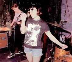 Kathleen Hanna of Bikini Kill in a Fugazi t-shirt