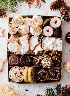 Christmas Cookie Box - Zoe - Christmas Cookie Box Holiday cookie box filled with sugar cookies, Gingerbread cookies, mocha hazelnut thumbprint cookies, hazelnut marshmallows, pistachio cranberry cookies and spiced praline meringues. Christmas Cookie Boxes, Christmas Food Gifts, Christmas Sweets, Holiday Cookies, Cranberry Cookies, Favorite Sugar Cookie Recipe, Sugar Cookies Recipe, Holiday Baking, Christmas Baking