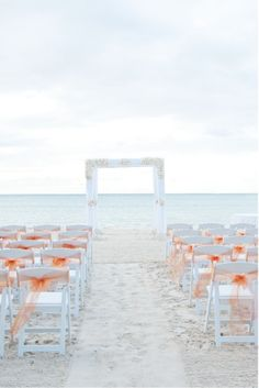 beach wedding chairs.  Simple tuille tied to chair backs.