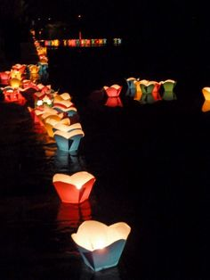 This would be so cool to do for a wedding !!!  Hoi An, candles on the river