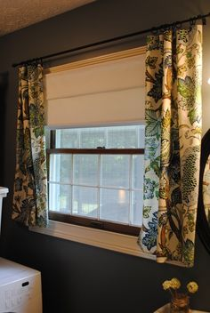 Extend a too short curtain rod with a rod in the middle! good idea ...