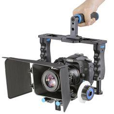 Neewer® Aleación de aluminio cámara jaula de vídeo película Kit película haciendo sistema incluye (1) jaula de vídeo + (1) Top Handle Grip + (2) 15 mm Rod + (1) caja mate + (1) Follow Focus, para DSLR Cámara Tales como Canon Nikon Sony Olympus: Amazon.es: Electrónica
