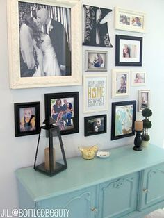 Great Room family gallery wall: love the comibination of color photos, bw photos, quotes, etc