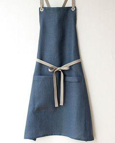 This shade of blue is a classic color in the kitchen, so our Slate-Blue Apron is a very popular - and practical - choice. This apron is elegant, but thoroughly tested and approved for durability. Sewing Aprons, Sewing Clothes, Cafe Apron, Restaurant Uniforms, Diy Vetement, Linen Apron, Apron Designs, Kitchen Aprons, Clothing Hacks
