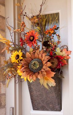 Autumn floral arrangement for a door. Nice alternative to a wreath.