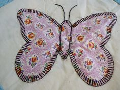 Vintage appliqued butterfly quilt top.