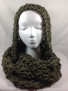 This handmade crocheted green/gold hooded infinity scarf shimmers with a twist and is very soft and warm. Made from Alpaca, it must be hand