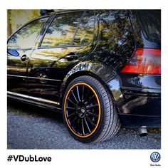 The custom red and gold rims on this black Mk4 Golf TDI remind us of home. #VDubLove