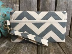 This cute wristlet wallet is the perfect go to alternative to our everyday handbags! It will hold all your necessities including credit cards, ID and your smartphone. Super convenient for the mom on the go, this bag leaves your hands free to take care of your kids and shop!!!