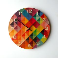 Looking at the clock would be fun with this one :) Objectify Grid2 Wall Clock With Numerals  by ObjectifyHomeware, $32.00