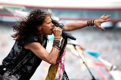 Steven Tyler Photos - Steven Tyler performs prior to the NASCAR Sprint Cup Series IRWIN Tools Night Race at Bristol Motor Speedway on August 22, 2015 in Bristol, Tennessee.