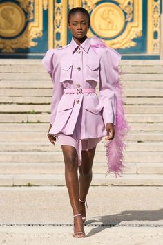 """Feather boas are back according to Nina Ricci, as they sashayed down the runway in several shimmering shades. Adornments were not in short supply for the accessories in the spring/summer 2018 collection - from tasselled bags and feather-embellished hats, to belts and shoes branded with the house's initials. In short? Pretty party wear in pastels.    [link url=""""http://www.vogue.co.uk/shows/spring-summer-2018-ready-to-wear/nina-ricci""""]See the full collection here.[/link]"""