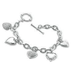 1/5 CT. T.W. Diamond Heart Assorted Charm Bracelet in Sterling Silver