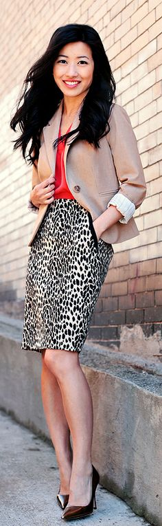This printed skirt may be edgy, but paired with the brown blazer and heels, makes this outfit office worthy.