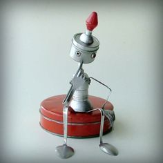 Cute robot from upcycled spoons, forks and hardware
