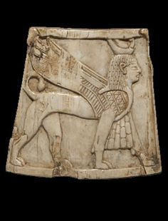 Carved ivory plaque from Nimrud showing a winged sphinx with apron and crown in the Egyptian style. 8th – 7th century BC. Phoenician style