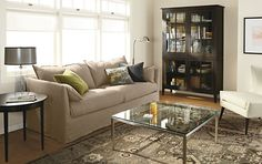 - Living - Room & Board  task lamp, cabinet, round table, glass lamp