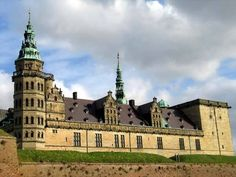 """Jelling Mounds, Runic Stones and Church, which are 10th century burial mounds found near Vejle on Jutland.    - Roskilde Cathedral, a royal chuch built in the 12th century for the city of Roskilde.    - Kronborg Castle (photo), famous for being the setting for """"Hamlet"""", located near Helsingor."""