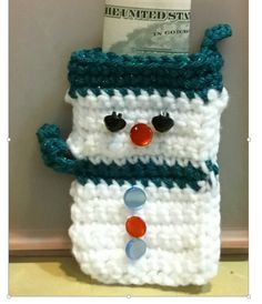 I have been creating snowman gift bags and thought a snowman treat holder ornament would be a companion to the bags. I used the same technique of creating a white body, changing to a colorful yarn to make the scarf and then white again for the head.