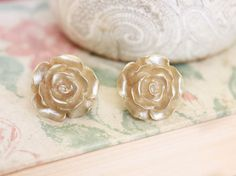 These are beautiful shimmering gold rose stud earrings. The resin rose has lovely details and is lightweight. The golden sparkle finish on this        $19