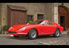"""1967 Ferrari 275 GTB/4 Berlinetta  The GTB/4 was an attempt to tame the classic 250 GTO for the road. The endless hood, glassed-in headlights, and vents behind the front fender all allude to that successful racer. The petite chrome mirrors, tiny bumpers, and Borrani wire wheels are elegant, road-going touches. Faye Dunaway drove a convertible version in The Thomas Crown Affair, calling it """"one of those red Italian things"""" and co-star Steve McQueen liked it so much he bought one."""